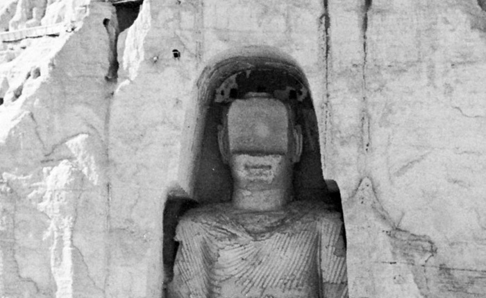 Buddha carved from the rock at Bamiyan, Afghanistan, fifth century (now destroyed). Courtesy of the Afghan Infor- mation Bureau, London.
